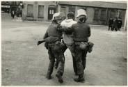 Battered and bleeding youth carried off by the police, Londonderry, Northern Ireland