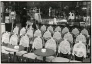 Chairs in front of cafe, Paris, France